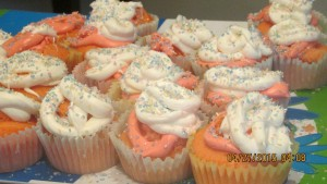 A plate of frosted cupcakes with fairy dust.
