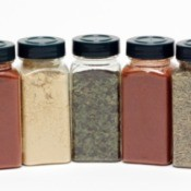 A collection of spice bottles with lids.