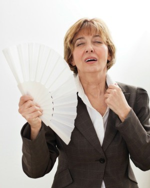 woman fanning herself