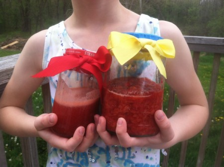 girl holding jars