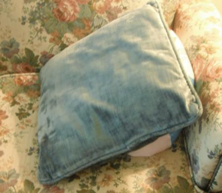 A pillow on top of a deflated beach ball.