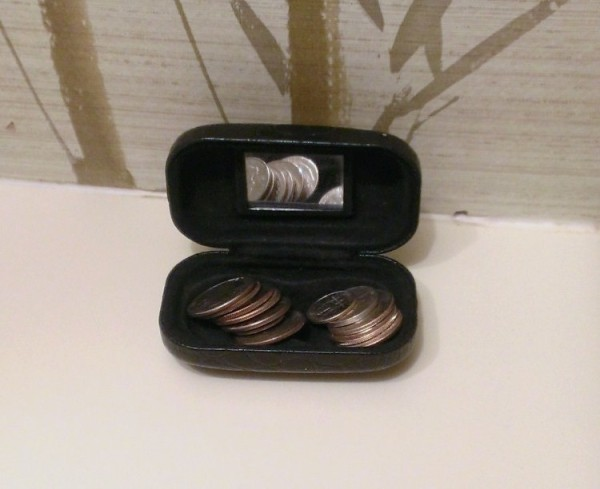 Store change in a contact lens case