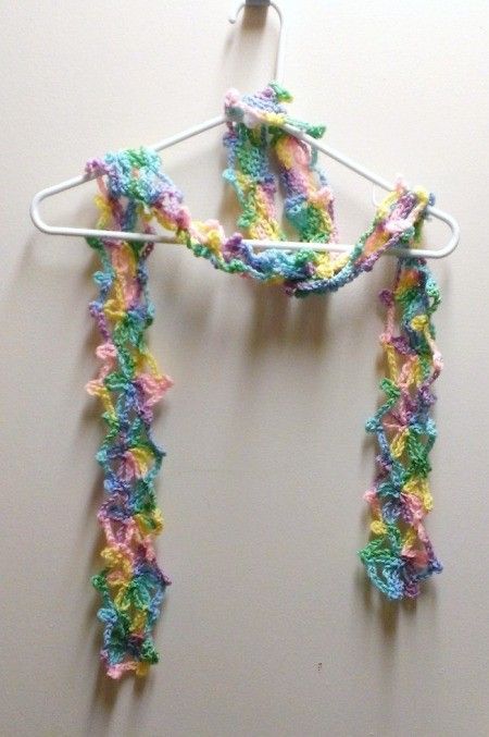 finished scarf hanging on clothes hanger