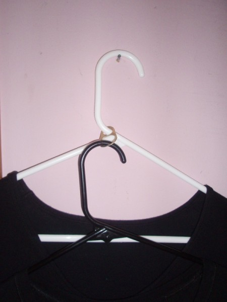 tab connecting two hangers