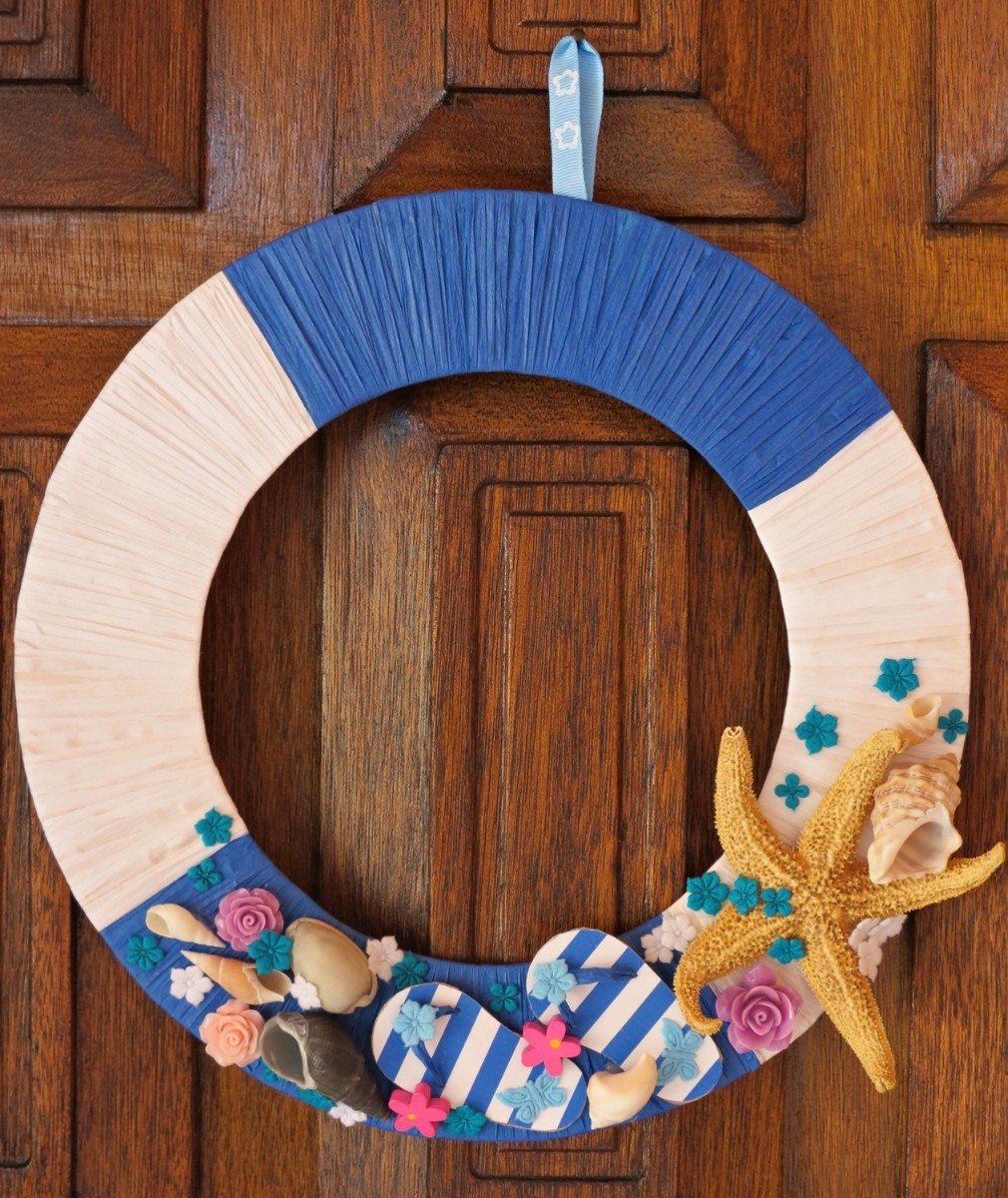 cead8a09431a Make this cute beach themed wreath for seasonal use or as a bit of decor  for a beach house. This is a guide about making a flip-flop beach wreath.
