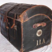 brown trunk with leather straps