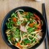 bowl of veggies, pork and noodles