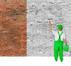 man painting brick