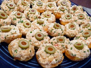 A plate of chicken gorgonzola stuffed apricot cups