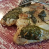 A plate of cooked tilapia.