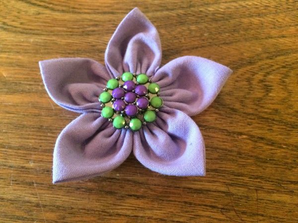 making a folded fabric flower