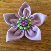 lavender fabric flower with aqua and lavender button in center