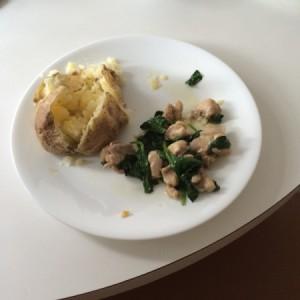 A garlic parmesan chicken dinner on a white plate.