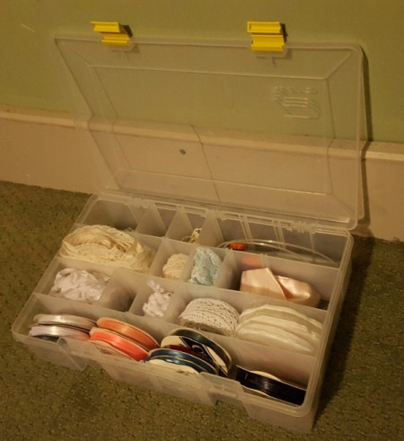open fishing supply box with craft supplies