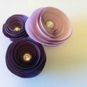 three spiral paper flowers in a cluster