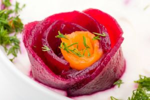 beet and carrot garnish on creamy soup