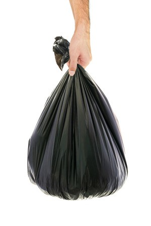 man holding trash bag