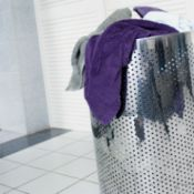 stainless steel laundry basket with dirty towels