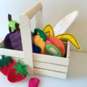 small wooden basket with a variety of handcrafted felt fruit