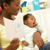 mom holding card and baby