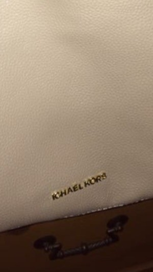 purse with missing letter