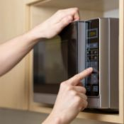 person operating microwave