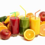 3 smoothie glasses and fruit