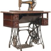 antique machine in cast iron and wood cabinet