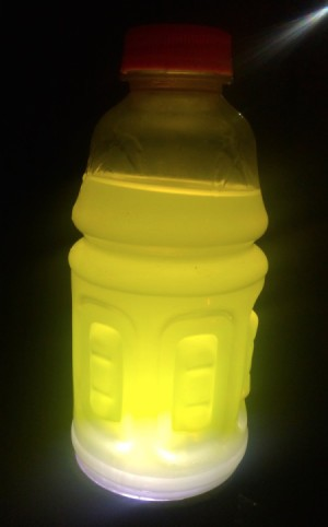 A sports drink with a light behind it, making a lantern.