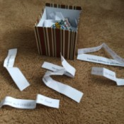 box with the paper strips