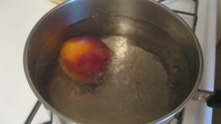 peach in boiling water