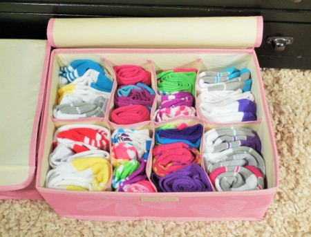 A sock drawer organizer filled with socks.