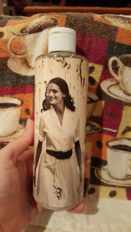 bottle of shampoo decorated with photo cutout