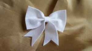 finished white felt bow
