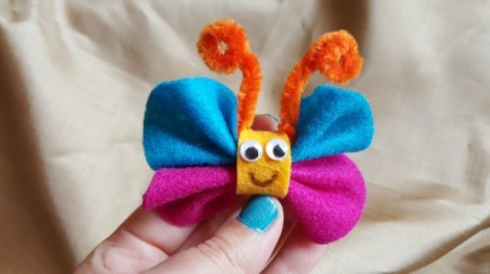 blue and magenta felt butterfly