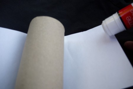 Easy Recycled Owl - Gluing paper to the toilet paper tube.