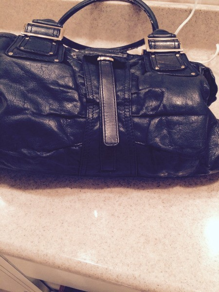 An old worn out leather handbag.