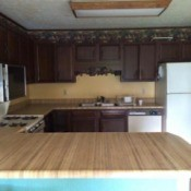 kitchen cabinets, countertop, and tile