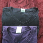 A collection of t-shirts that have been altered into V-necks.