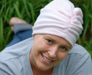 woman wearing a fleece chemo turban