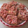 Squares of treats made with Lucky Charms cereal.