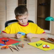 boy making Christmas decorations