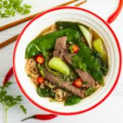 Asian style soup with strips of steak