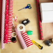paper, scissors, tape, and other gift wrap supplies