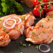 raw pork steaks with tomatoes and onions