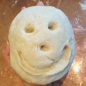 ball of clay with smiley face