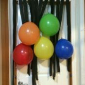A birthday banner with balloons and streamers.