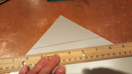 Using a ruler to draw a straight line.