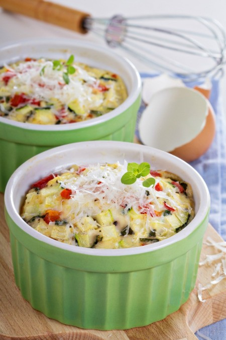 two baking dishes with veggie omelettes