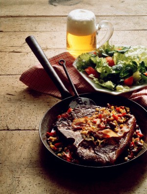 steak in skillet with corn and beans